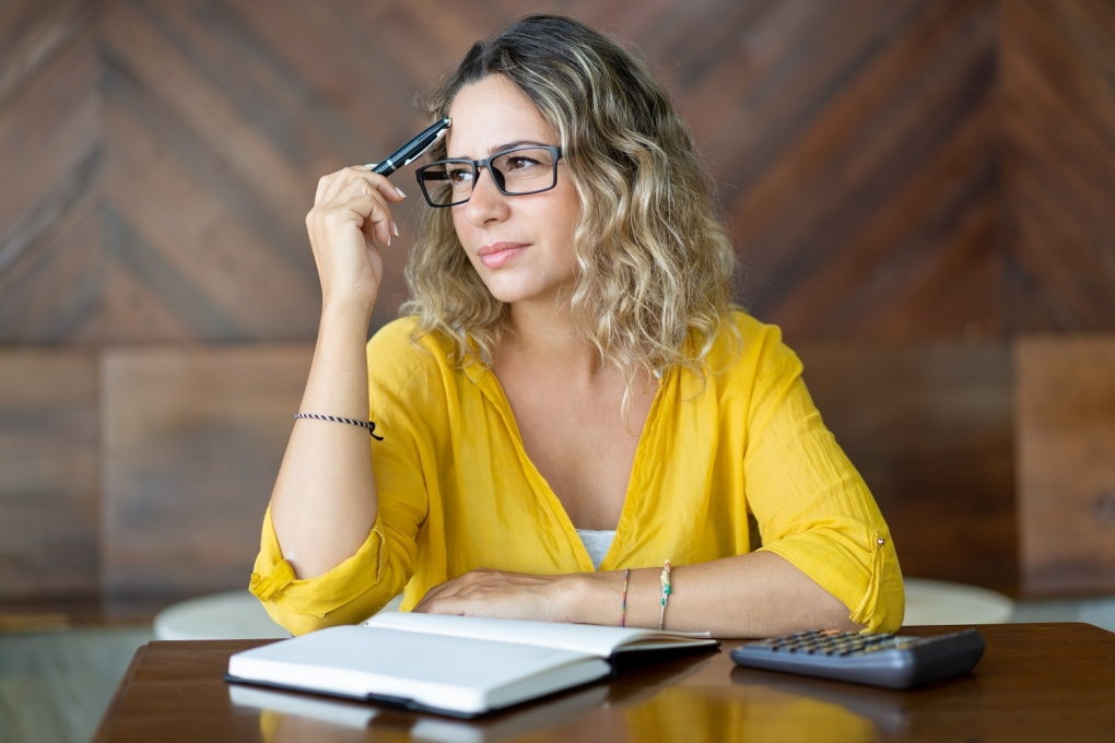 Canva Pensive woman trying to remember important thing